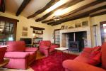 the superb lounge with its stone fireplace