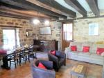 it has a cosy sitting/dining room with fireplace