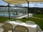The rpivate terrace enjoys a great view over the pool and garden