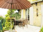 the terrace overlooking the pool and garden